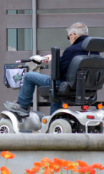 Elderly man drive mobility scoote